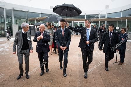 (L-R) Martin Vetterli, president of the EPFL, Swiss Federal President Ueli Maurer, H.R.H. Hereditary Prince Alois of Liechtenstein, walk under the snow at the Ecole polytechnique federale de Lausanne (EPFL), the research institute and university in Lausanne during a two day state visit to Switzerland, in Lausanne, Switzerland,