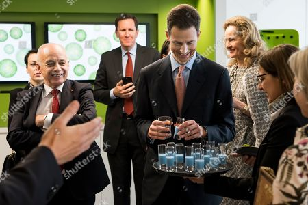 Swiss Federal President Ueli Maurer (L) and Hereditary Prince Alois of Liechtenstein (R) drink a vegan milk at the Nestle Research center in Lausanne, Switzerland, 04 April 2019. Liechtenstein royal couple is on a two day state visit to Switzerland.