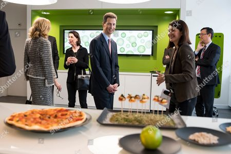 Hereditary Prince Alois of Liechtenstein (C) looks at a vegan pizza at the Nestle Research center in Lausanne, Switzerland, 04 April 2019. Liechtenstein royal couple is on a two day state visit to Switzerland.