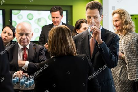 Stock Photo of Swiss Federal President Ueli Maurer (L) and Hereditary Prince Alois of Liechtenstein (R) drink a vegan milk at the Nestle Research center in Lausanne, Switzerland, 04 April 2019. Liechtenstein royal couple is on a two day state visit to Switzerland.