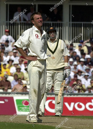 Editorial picture of England V Australia Ashes 5th Test At The Oval Englands Phil Tufnell Watches As Mark Waugh Dispatches Him To The Boundary Again.