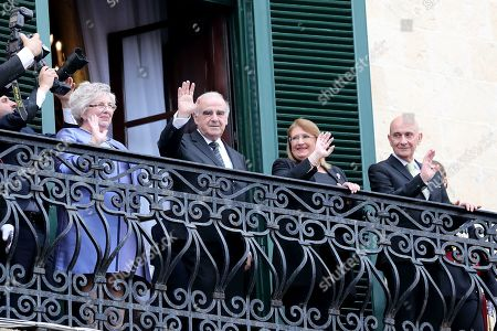 Malat's President George Vella (2-L) and his wife Miriam Grima (L), his predecessor Marie-Louise Coleiro Preca (2-R) and her husband Edgar Preca (R) wave from a balcony after Vella was sworin in at the Grandmaster's Palace in Valletta, Malta, 04 April 2019. ella was sworn in as President following his win in the 02 April 2019 elections.