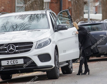 Stock Image of Lauryn Goodman hides getting out of the passenger seat of her sister Chloe Goodman's car as they leave Hove Trial centre after Lauryn received a suspended sentence