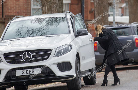 Lauryn Goodman hides getting out of the passenger seat of her sister Chloe Goodman's car as they leave Hove Trial centre after Lauryn received a suspended sentence