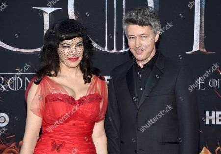 "Aidan Gillen, Camille O'Sullivan. Aidan Gillen, right, and Camille O'Sullivan attend HBO's ""Game of Thrones"" final season premiere at Radio City Music Hall, in New York"