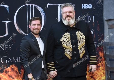 """Kristian Nairn, right, and guest attend HBO's """"Game of Thrones"""" final season premiere at Radio City Music Hall, in New York"""