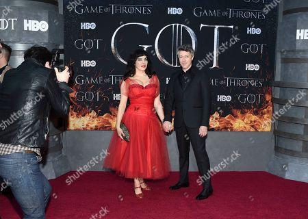 "Camille O'Sullivan, Aiden Gillen. Actor Aiden Gillen, right, and partner Camille O'Sullivan attend HBO's ""Game of Thrones"" final season premiere at Radio City Music Hall, in New York"