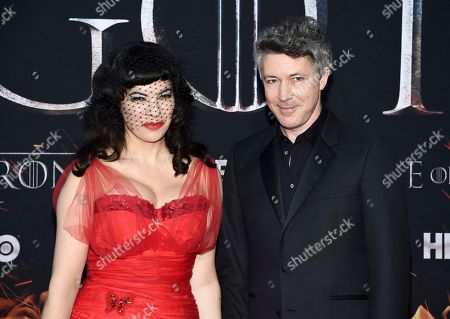 """Stock Photo of Camille O'Sullivan, Aiden Gillen. Actor Aiden Gillen, right, and partner Camille O'Sullivan attend HBO's """"Game of Thrones"""" final season premiere at Radio City Music Hall, in New York"""