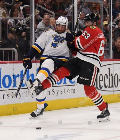 Chicago Blackhawks defenseman Carl Dahlstrom (63) and St. Louis Blues left wing Pat Maroon (7) collide during the second period of an NHL hockey game, in Chicago