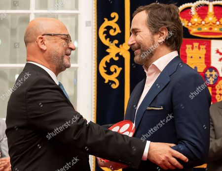 Stock Photo of US diplomat James Costos (R), who was US Ambassador to Spain from 2013 to 2017, receives the first tittle of 'Honorary Ambassador' from the President of the Spain Film Commission (SFC), Carlos Rosado, during a ceremony held in Seville, Spain, 04 April 2019. Costos was awarded in recognition to his efforts in the internationalization of the Spanish cinema and facilitation for the shooting in Spain of the fifth season of the 'Game of Thrones' series or movies like 'The Bourne Identity' or 'Exodus'.