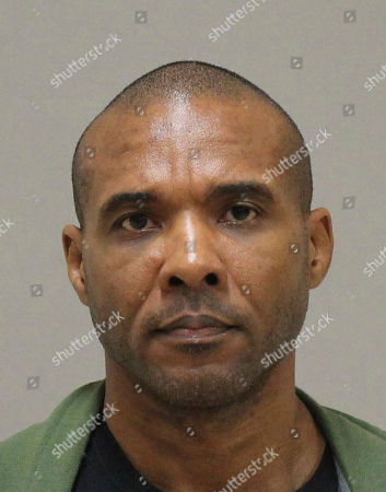 Stock Image of Provided by the Kent County Michigan Sheriff's office shows Cedric Marks in Grand Rapids, Mich. The 44-year-old MMA fighter and his girlfriend have been indicted in Texas on capital murder charges in the killings of two people whose bodies were found in a shallow grave in Oklahoma. Bell County District Attorney Henry Garza says the indictments of Marks and 26-year-old Maya Maxwell were handed down, for the deaths Jenna Scott and Michael Swearingin