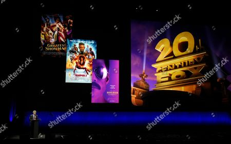 Alan Horn, chairman of The Walt Disney Studios, speaks underneath poster images for 20th Century Fox films during the Walt Disney Studios Motion Pictures presentation at CinemaCon 2019, the official convention of the National Association of Theatre Owners (NATO) at Caesars Palace, in Las Vegas