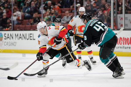 Derek Ryan, Jaycob Megna. Calgary Flames' Derek Ryan, left, is defended by Anaheim Ducks' Jaycob Megna during the third period of an NHL hockey game, in Anaheim, Calif. The Ducks won 3-1