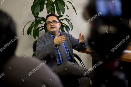 Juan Francisco Sandoval, Guatemala's lead prosecutor against impunity, gives an interview in Guatemala City, . Sandoval said President Jimmy Morales' government has done everything possible to block his investigations into high-level corruption, including of the president himself
