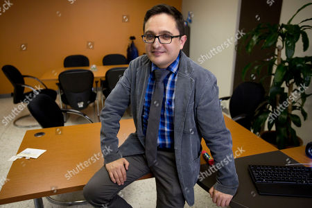 Juan Francisco Sandoval, Guatemala's lead prosecutor against impunity, poses for a photo during an interview in Guatemala City, . Sandoval said President Jimmy Morales' government has done everything possible to block his investigations into high-level corruption, including of the president himself
