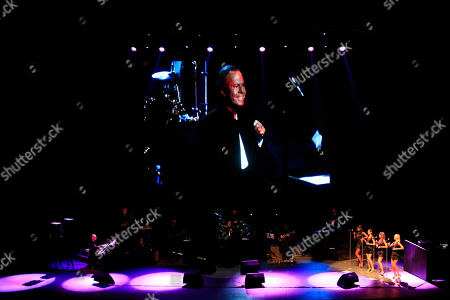 Spain's singer Julio Iglesias is projected on a screen as he performs at the National Auditorium in Mexico City