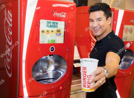 Stock Picture of In this photo released, Mario Lopez visits his local Burger King in Los Angeles to find a blast from the past with a new twist. New Surge flavors Cherry Rush, Grape Glory and Vanilla Vibe now available exclusively on Coca-Cola Freestyle at participating Burger King restaurants