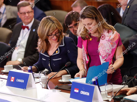 Chrystia Freeland, Ekaterina Zaharieva. Canada's Minister of Foreign Affairs Chrystia Freeland, right, looks over her paperwork as she take her seat next to Bulgarian Foreign Minister Ekaterina Zaharieva, left, at the Meeting of the North Atlantic Council in Foreign Ministers' Session 1 at the U.S. State Department in Washington