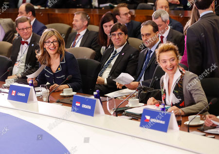 Ekaterina Zaharieva, Marija Pejcinovic Buric. Bulgarian Foreign Minister Ekaterina Zaharieva, left, and Croatian Deputy Prime Minister and Foreign Minister Marija Pejcinovic Buric, right, smile as they take their seats at the Meeting of the North Atlantic Council in Foreign Ministers' Session 1 at the U.S. State Department in Washington