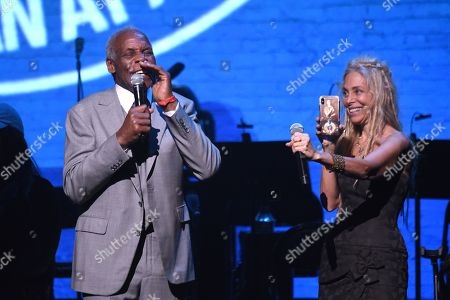 Stock Photo of Danny Glover and Wendy Oxenhorn