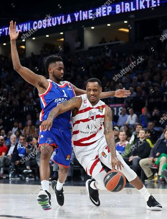 Stock Picture of Milan's James Nunnally (R) in action against Anadolu's Rodrigue Beaubois (L) during the Euroleague basketball match between Anadolu Efes Istanbul and Armani Olimpia Milan in Istanbul, Turkey, 04 April 2019.