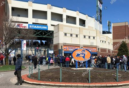 Fans lined up outside NBT Bank Stadium in Syracuse, N.Y., as Tim Tebow is expected to play in the opening-day minor league baseball game with the Triple-A Syracuse Mets. The former Heisman Trophy winner and NFL quarterback is trying to make it to the major leagues with the New York Mets organization