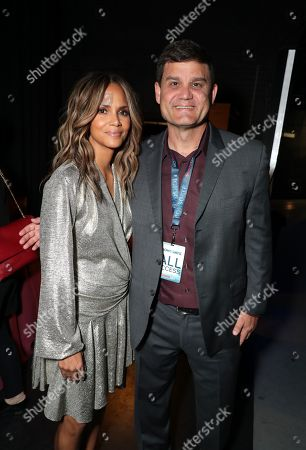 Halle Berry from 'John Wick: Chapter 3 - Parabellum' and Jason Constantine, President of Acquisitions and Co-Productions of Lionsgate Motion Picture Group, attend the Lionsgate CinemaCon presentation at the Colosseum at Caesar's Palace