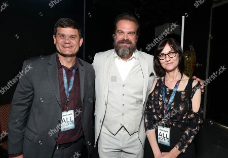 Jason Constantine, President of Acquisitions and Co-Productions of Lionsgate Motion Picture Group, David Harbour from 'Hellboy' and Eda Kowan, Lionsgate EVP of Acquisitions and Co-Productions, attend the Lionsgate CinemaCon presentation at the Colosseum at Caesar's Palace