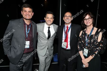 Stock Image of Jason Constantine, President of Acquisitions and Co-Productions of Lionsgate Motion Picture Group, David Spitz, Lionsgate President of Domestic Distribution, Mike Polydoros, Lionsgate Films' EVP of Distribution Operations, and Eda Kowan, Lionsgate EVP of Acquisitions and Co-Productions, from XXX attends the Lionsgate CinemaCon presentation at the Colosseum at Caesar's Palace
