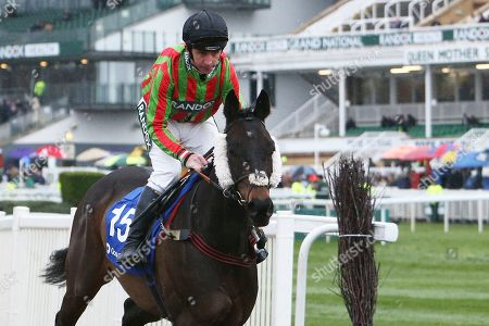 Movie Legend and jockey Leighton Aspell on their way to the start for the 4.40pm The Close Brothers Red Rum Handicap Steeple Chase (Grade 3) 2m during the Grand National Festival Week at Aintree, Liverpool