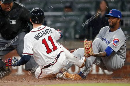 Ender Inciarte, Carl Edwards Jr. Atlanta Braves' Ender Inciarte (11) beats the tag from Chicago Cubs relief pitcher Carl Edwards Jr. (6) to score on a wild pitch in the fifth inning of baseball game, in Atlanta