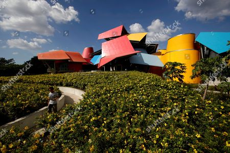 A tourist walks through the gardens of the Museum of Natural History of Panama (Biomuseo), designed by Canadian architect Frank Gehry, in Panama City, Panama, 04 April 2019. Its intention is to change the way we see, understand and conserve nature and its biodiversity.