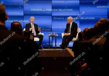 Jamie Dimon, Chairman and CEO, JPMorgan Chase, left, responds to questions by Carlyle Group co-CEO David Rubenstein, right, at the Council on Foreign Relations, in New York