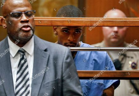 Stock Photo of Christopher Darden, Eric Holder. Eric Holder, the suspect in the killing of rapper Nipsey Hussle is seen in Los Angeles County Superior Court with his attorney Christopher Darden, left, . Holder is charged with murder and two counts of attempted murder in connection with the attack outside Hussle's The Marathon clothing store on Sunday