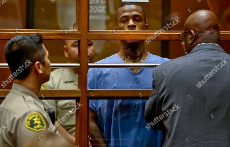 Stock Image of Christopher Darden, Eric Holder. Eric Holder, center, the suspect in the killing of rapper Nipsey Hussle is seen with his attorney, Christopher Darden, front, in Los Angeles County Superior court . Holder, 29, is charged with murder and two counts of attempted murder in connection with the attack outside Hussle's The Marathon clothing store on Sunday