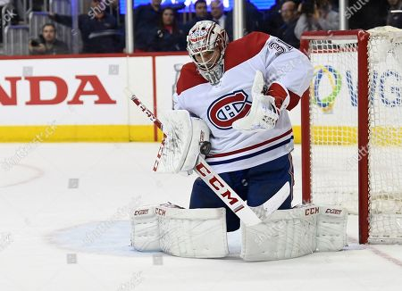 67dfd18dda7093 Montreal Canadiens goaltender Carey Price blocks a shot by the Washington  Capitals during the second period