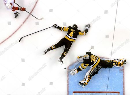 Stock Picture of Detroit Red Wings' Martin Frk (42) can't get a shot past Pittsburgh Penguins goaltender Matt Murray (30) and defenseman Justin Schultz (4) in the third period of an NHL hockey game in Pittsburgh, . The Penguins won 4-1