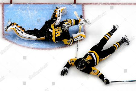 Stock Image of Pittsburgh Penguins goaltender Matt Murray (30) and defenseman Justin Schultz (4) block a shot by Detroit Red Wings' Martin Frk in the third period of an NHL hockey game in Pittsburgh, . The Penguins won 4-1