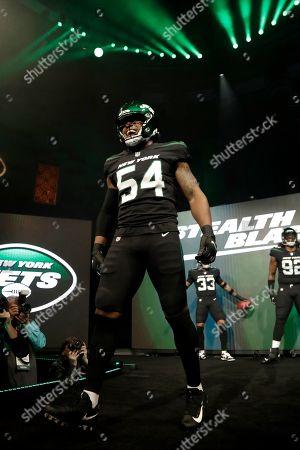 """New York Jets inside linebacker Avery Williamson models the NFL football team's new """"stealth black"""" uniform, in New York"""