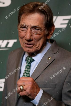 Former New York Jets quarterback Joe Namath poses for photographers on the green carpet ahead of an event unveiling the NFL football team's new uniforms, in New York