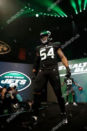 New York Jets inside linebacker Avery Williamson models the team's new NFL football uniforms, in New York