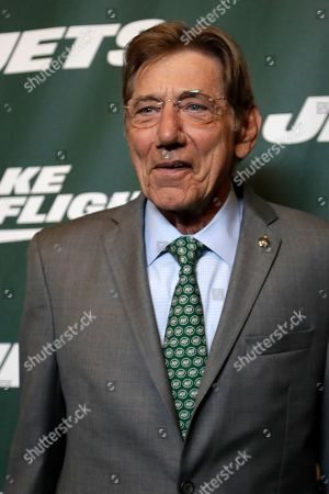 Former New York Jets quarterback Joe Namath poses for photographers on the green carpet ahead of an event unveiling the team's new NFL football uniforms, in New York