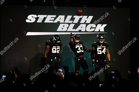 New York, New York, U.S. - New York Jets safety Jamal Adams (33), defensive end Leonard Williams (92) and inside linebacker Avery Williamson (54) unveil Stealth Black color uniforms Thursday, April. 4, 2019, at Gotham Hall in New York City. The NFL Football team is scheduled to wear the uniforms during the regular season