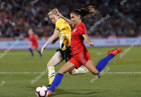Alex Morgan, alex morgan. U.S. forward Alex Morgan, front, shoots as Australia's Clare Polkinghorne defends during the second half of an international friendly soccer match, in Commerce City, Colo. The United States won 5-3