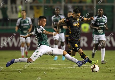 Christian Rivera (L) of Deportivo Cali in action against Jose Ortigoza (R) of Guarani during the Copa Sudamericana soccer match between Deportivo Cali and Guarani at Deportivo Cali Stadium in Cali, Colombia, 04 April 2019.