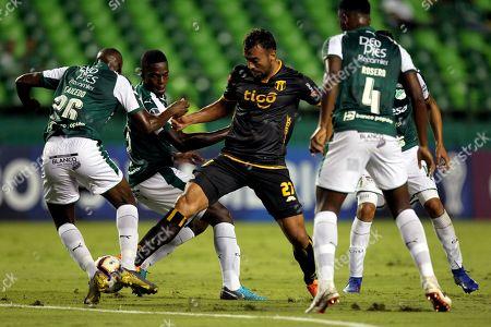 Juan Caicedo (L) Deportivo Cali in action against Ramon Martinez (C) of Guarani during the Copa Sudamericana soccer match between Deportivo Cali and Guarani at Deportivo Cali Stadium in Cali, Colombia, 04 April 2019.
