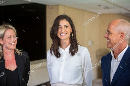 Lamisse Hamouda (C), daughter of Hazem Hamouda, speaks to the media alongside journalist Peter Greste (R) and her family's lawyer Jennifer Robinson (L) at Queensland Parliament House in Brisbane, Australia, 04 April 2019 (issued 05 April 2019). Egyptian-Australian man, Hazem Hamouda, is on his way back to Brisbane after more than a year without charge in a Cairo prison.