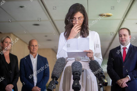 Stock Image of Lamisse Hamouda (C), daughter of Hazem Hamouda, speaks to the media alongside her family's lawyer Jennifer Robinson (L), journalist Peter Greste (2-L) and MP for Stretton Duncan Pegg (R) at Queensland Parliament House in Brisbane, Australia, 04 April 2019 (issued 05 April 2019). Egyptian-Australian man, Hazem Hamouda, is on his way back to Brisbane after more than a year without charge in a Cairo prison.
