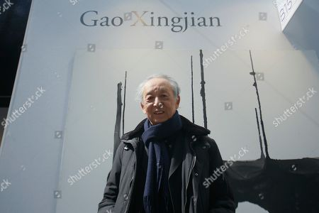 Stock Picture of Gao Xingjian 2000 Nobel Prize for Literature with his artwork