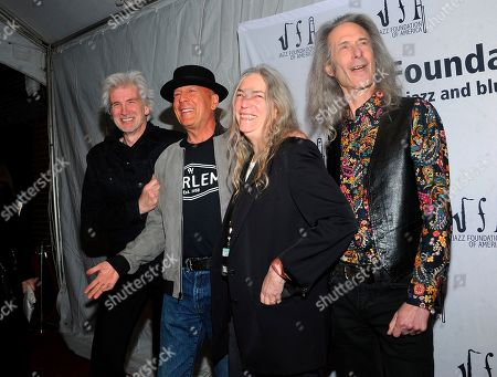 """Tony Shanahan, Patti Smith, Lenny Kaye, Bruce Willis. Tony Shanahan, from left, Bruce Willis, Patti Smith, and Lenny Kaye walk the red carpet at the Jazz Foundation of America's 17th annual """"A Great Night In Harlem"""" gala concert at the Apollo Theater, in New York"""